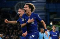 Chelsea's David Luiz celebrates scoring his side's second goal in a shock 2-0 win over Manchester City