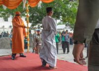 Dozens in the crowd in Indonesia's conservative Muslim province of Aceh jeered and called for the men to be whipped harder