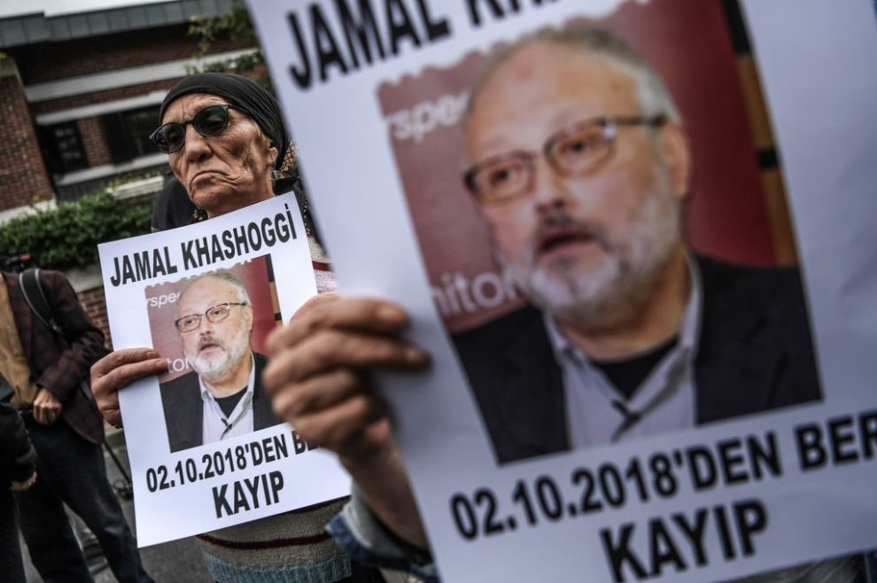 Protesters hold a portrait of journalist and Riyadh critic Jamal Khashoggi, who was killed in October 2018.