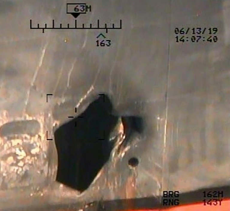 U.S. Department of Defense has released further images of hull damage to an oil tanker damaged last week in the Gulf of Oman (AFP).