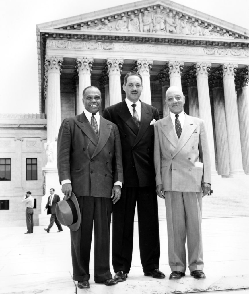 George E.C. Hayes, left, Thurgood Marshall, center, and James M. Nabrit pose outside the U.S. Supreme Court in Washington, D.C. on May 17, 1954. The three lawyers led the fight for abolition of segregation in public schools before the Supreme Court, which ruled today that segregation is unconstitutional. (AP Photo)