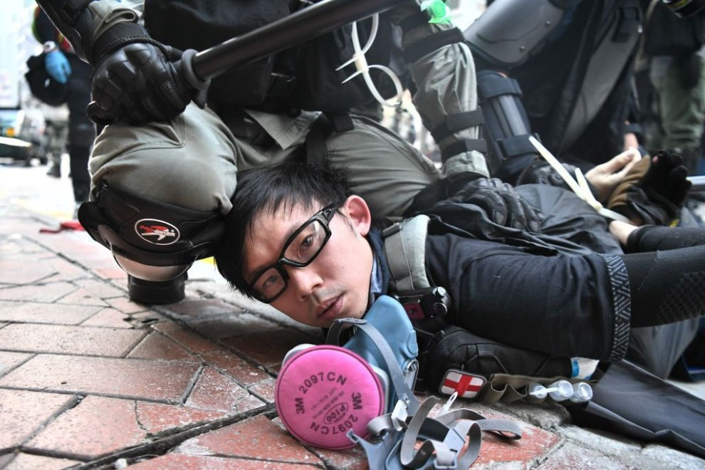 TOPSHOT - A protester is detained by police as violent demonstrations take place in the streets of Hong Kong on October 1, 2019, as the city observes the National Day holiday to mark the 70th anniversary of communist China's founding. - Police fanned out across Hong Kong on October 1 in a bid to deter pro-democracy protests as the city marked communist China's 70th birthday, with local officials attending a closed door flag-raising ceremony behind closed doors. (Photo by Anthony WALLACE / AFP) (Photo by ANTHONY WALLACE/AFP via Getty Images)