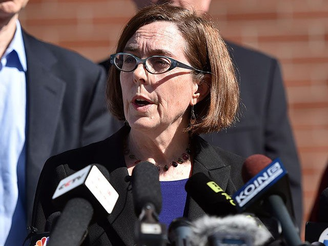 Oregon Governor Kate Brown reacts during a press conference in Roseburg, Oregon on October 2, 2015. As police and mourners groped for answers in the latest carnage to hit gun-crazed America, a portrait started to emerge Friday of the Oregon community college shooter: an angry recluse who hated religion. The …