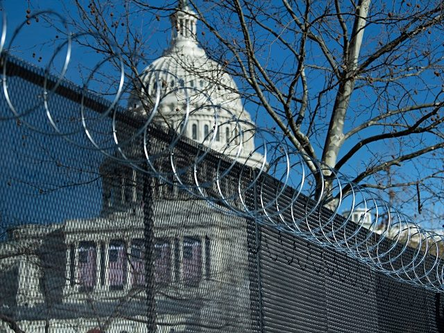 Razor wire is installed atop a security fence in preparation for next week's Presidential inauguration a week after a pro-Trump mob broke into and took over the Capitol, January 14, 2021, in Washington, DC. - The center of Washington was on lockdown Thursday as more than 20,000 armed National Guard …