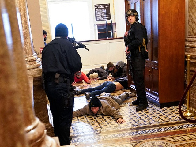 U.S. Capitol Police hold protesters at gun-point near the House Chamber inside the U.S. Capitol on Wednesday, Jan. 6, 2021, in Washington. (AP Photo/Andrew Harnik)