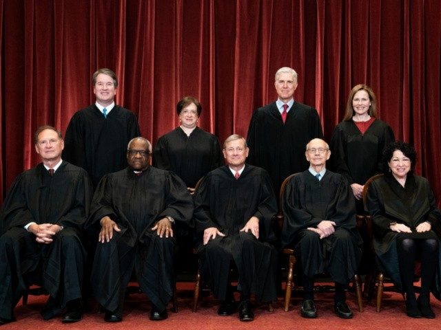 WASHINGTON, DC - APRIL 23: Members of the Supreme Court pose for a group photo at the Supreme Court in Washington, DC on April 23, 2021. Seated from left: Associate Justice Samuel Alito, Associate Justice Clarence Thomas, Chief Justice John Roberts, Associate Justice Stephen Breyer and Associate Justice Sonia Sotomayor, …