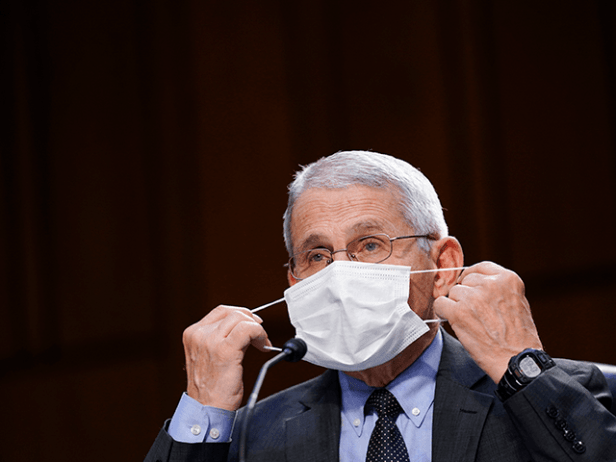 Dr. Anthony Fauci, director of the National Institute of Allergy and Infectious Diseases, adjusts a face mask during a Senate Health, Education, Labor and Pensions Committee hearing on the federal coronavirus response on Capitol Hill on March 18, 2021 in Washington, DC. (Photo by Susan Walsh-Pool/Getty Images)