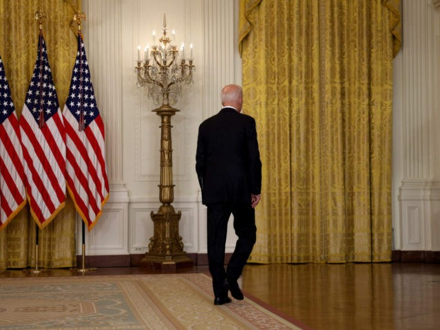 WASHINGTON, DC - AUGUST 16: U.S. President Joe Biden walks away without taking questions after delivering remarks on the worsening crisis in Afghanistan from the East Room of the White House August 16, 2021 in Washington, DC. Biden cut his vacation in Camp David short to address the nation as the Taliban have seized control in Afghanistan two weeks before the U.S. is set to complete its troop withdrawal after a costly two-decade war. (Photo by Anna Moneymaker/Getty Images)
