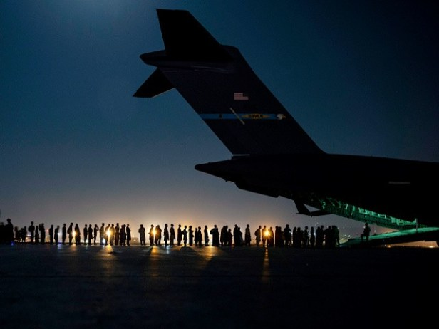 KABUL, AFGHANISTAN - AUGUST 21: In this handout provided by the U.S. Air Force, an air crew prepares to load evacuees aboard a C-17 Globemaster III aircraft in support of the Afghanistan evacuation at Hamid Karzai International Airport on August 21, 2021 in Kabul, Afghanistan. (Photo by Taylor Crul/U.S. Air Force via Getty Images)