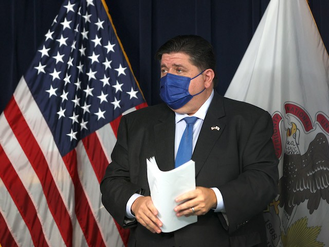 Citing substantial spread of the coronavirus across the state, Illinois Governor J.B. Prtizker announces a statewide mandate requiring masks be worn in all Illinois public schools, preschool through high school, on August 04, 2021 in Chicago, Illinois. Masks will also be required in all long-term care facilities and vaccinations will be required for all state employees at congregate facilities. (Scott Olson/Getty Images)