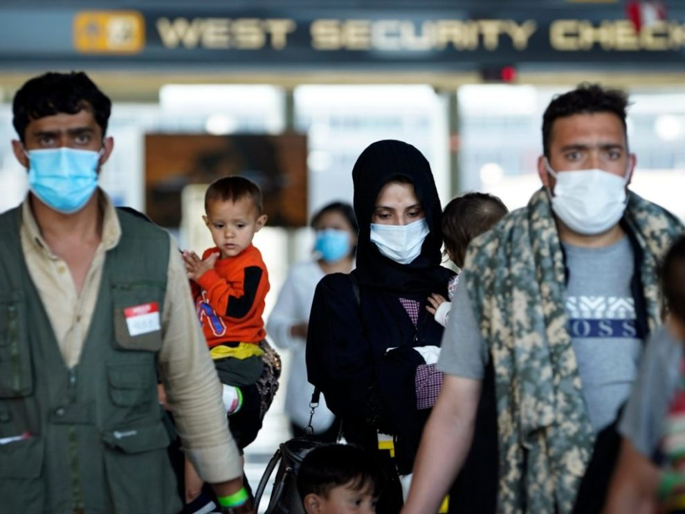 Afghan refugees arrive at Dulles International Airport in Northern Virginia while en route to military facilities in the U.S. (Jack Gruber-USA TODAY)