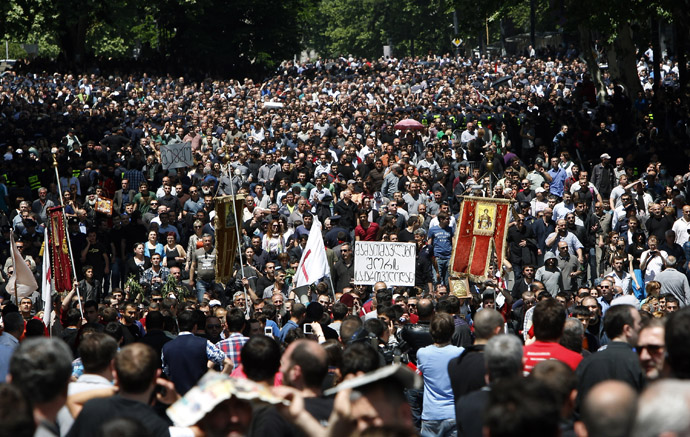 Orthodox Christian activists march before clashes with gay rights activists at an International Day Against Homophobia and Transphobia (IDAHO) rally in Tbilisi