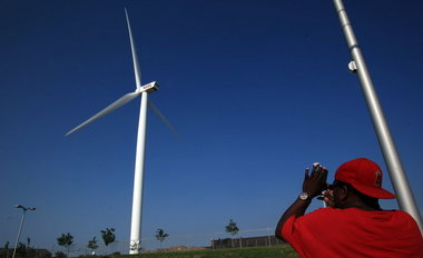 Wind turbine starts up in Euclid above Lincoln Electric Co     Joshua Gunter  The Plain DealerDon Robinson of Cleveland snaps a photo of  the giant wind turbine above Lincoln Electric Co  in Euclid Sunday