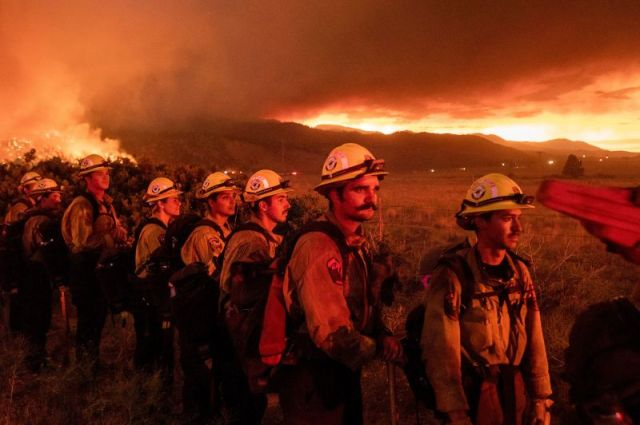 Firefighters monitor the Sugar Fire in Doyle, California, on July 9.