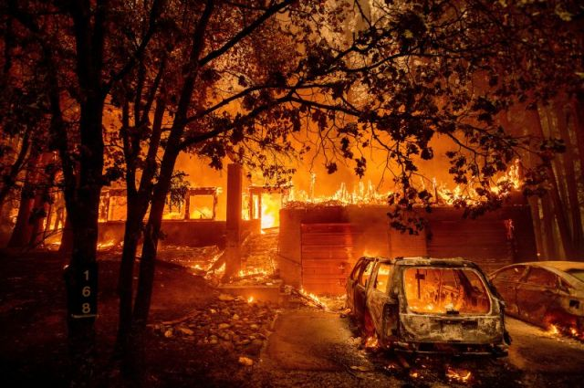 Flames consume a home as the Dixie Fire tears through the Indian Falls community of Plumas County, California, on July 24.