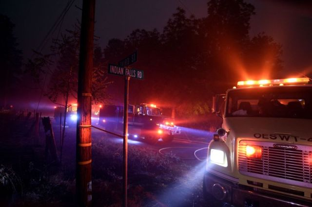 Firefighters try to reach a fire site in Quincy, California, on July 25.