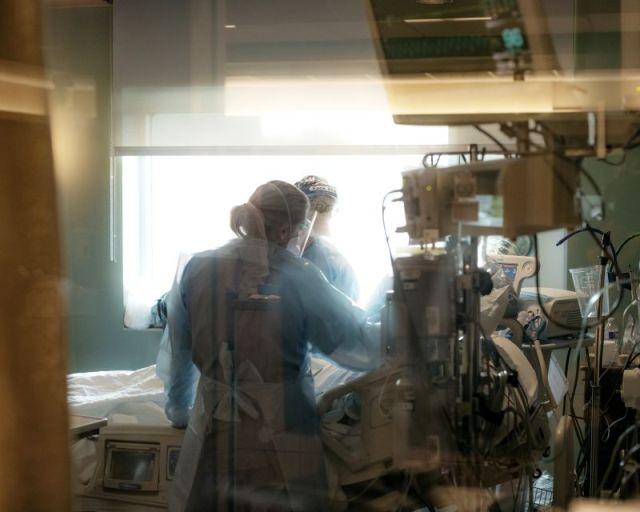 Nurses check on a patient in the ICU Covid-19 ward at NEA Baptist Memorial Hospital in Jonesboro, Arkansas, on Wednesday, August 4.