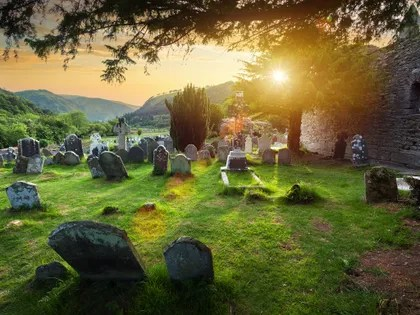 Image may contain: Tomb, Human, Person, Tombstone, Art, Painting, Plant, and Grass