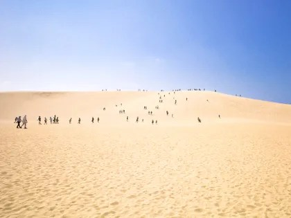 Image may contain: Soil, Sand, Outdoors, Nature, Dune, Human, Person, and Desert