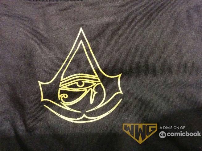 Assassin's Creed Origins: una maglietta svela logo ed artwork
