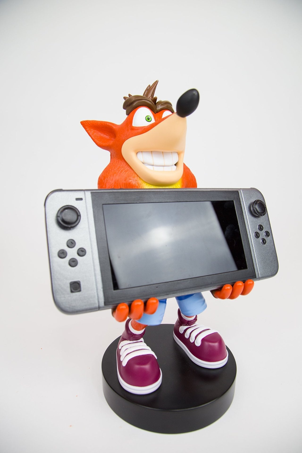 This Crash Bandicoot Statue Will Happily Hold Your