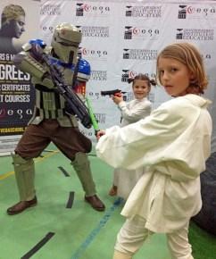 Braiden as a Rogue One Trooper, Jasmin as Leia and Gabriel as Luke.