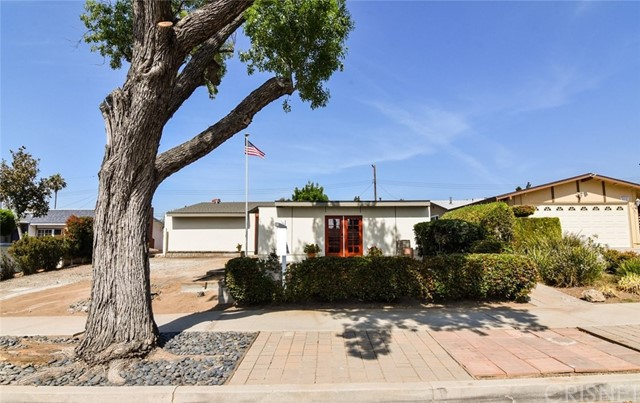Best Deal In Chatsworth. Newly renovated Main House Plus Income!3 bdr/2ba 1510 sq ft Primary Residence.1 bdr/1ba   450 sq ft Permitted Granny Flat. Nice clean, quiet and safe neighborhood. Everything's been redone. It's like a new home! Wide open floor plan w/dramatic vaulted ceilings. Super light,bright and airy! Gorgeous porcelain faux wood flooring throughout. Built in appliances. New Roof. RV Parking and so much more. Minutes from schools, shopping and transportation.