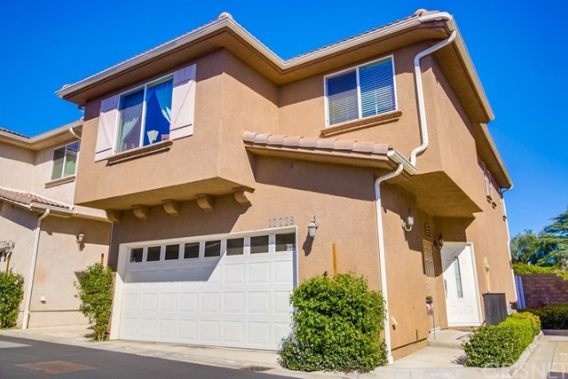This beautifully remodeled home, is the only detached home in this small gated community, and is set back in the community away from the front gate and street, making it very quiet and peaceful. The home was built in 2008 and offers 3 spacious bedrooms and 2.5 bathrooms. It is located in the heart of Northridge, in close proximity to CSUN. There are upgraded features throughout:- Living room with fireplace, recessed lighting and high ceilings; Kitchen with granite counters, stainless steel appliances and ample cabinets. Upstairs you will find three bedrooms including master suit with walk-in closet and private bathroom. Other features include: Attached Two car garage with direct access; hardwood floor in living room; Very private outdoor patio, great for entertaining and relaxation; plenty of closet and storage space; Copper plumbing; Central heat and A/C with smart thermostat; Secured gated complex. This is a move in ready home and is a must see.