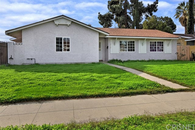 Come see this Chatsworth Gem! It offers a open floor plan with 3 large bedrooms, 2 remodeled bathrooms, wood laminate floors, fire place, central HVAC, remodeled kitchen with plenty of cabinets. There are smooth ceilings with recessed lights, dual pane windows and separate laundry area. This property sits on a large lot with a detached garage and possible RV access. Seller is motivated!