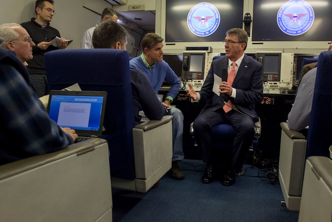 Defense Secretary Ash Carter speaks with reporters aboard a military aircraft as he flies to Brussels, Feb. 9, 2016, to attend a NATO defense ministers meeting and host a meeting on the fight against the Islamic State of Iraq and the Levant. DoD photo by Air Force Senior Master Sgt. Adrian Cadiz