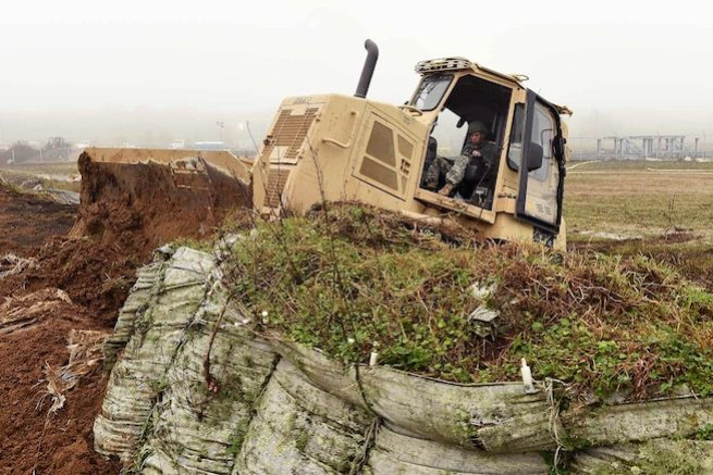 Army Pfc. Austin Burdette repairs a levee before expected river flooding in Krotz Springs, La., Jan. 8, 2016. Burdette is assigned to the Louisiana National Guard's 769th Brigade Engineer Battalion, 256th Infantry Brigade Combat Team. Louisiana Air National Guard photo by MSgt. Toby Valadie