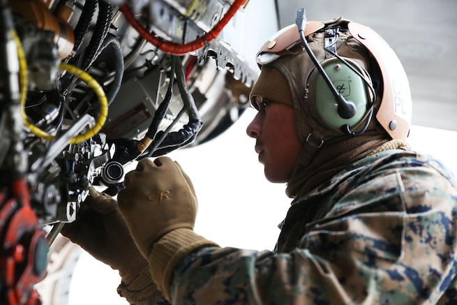Marine Corps Sgt. Avelinobong Quero works on an F/A-18D Hornet aircraft on Chitose Air Base in Hokkaido, Japan, Jan. 13, 2016. Quero is a fixed-wing aircraft mechanic assigned to Marine All Weather Fighter Attack Squadron 224. U.S. Marine Corps photo by Cpl. Jessica Quezada