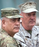 Army Gen. John Campbell, foreground, outgoing commander of U.S. Forces Afghanistan and NATO's Resolute Support Mission, and Marine Corps Gen. Joseph F. Dunford Jr., chairman of the Joint Chiefs of Staff, wait to begin the change-of-command ceremony in Kabul, Afghanistan, March 2, 2016. DoD photo by D. Myles Cullen