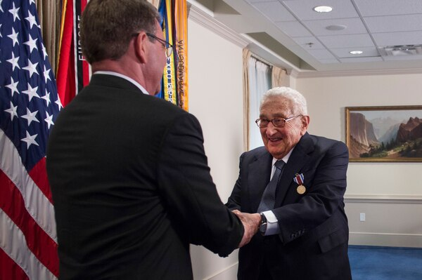 Defense Secretary Ash Carter shakes former Secretary of State Henry A. Kissinger's hand during an award ceremony at the Pentagon honoring Kissinger for his years of distinguished public service, May 9, 2016. Kissinger received the Department of Defense Distinguished Public Service Award. DoD photo by Air Force Senior Master Sgt. Adrian Cadiz