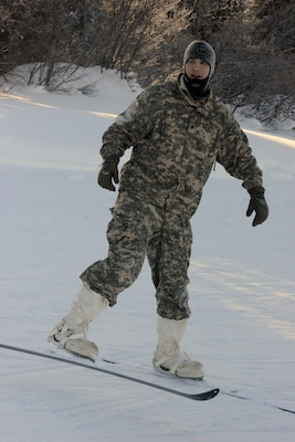 Army Spc. Elijah Mainini, a student at the Northern Warfare Training Center in Alaska, wears a size 16 boot and can't fit into a standard-issue Army vapor-barrier boot. He was issued Canadian forces mukluks and Jager skis. DoD photo by David Vergun