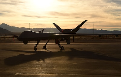 An Air Force MQ-9 Reaper unmanned aircraft awaits maintenance at Creech Air Force Base, Nev., Dec. 8, 2016. The Air Force is set to retire the MQ-1 Predator and transition solely to the more capable MQ-9 in early 2018. Air Force photo by Senior Airman Christian Clausen