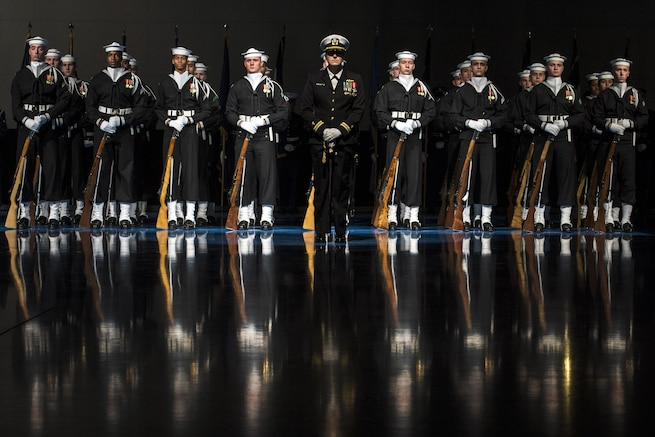 The U.S. Navy Ceremonial Guard assigned to Naval District Washington, D.C., stands in formation during Defense Secretary Carter's farewell ceremony at Joint Base Myer-Henderson Hall, Va., Jan. 9, 2016. DoD photo by EJ Hersom