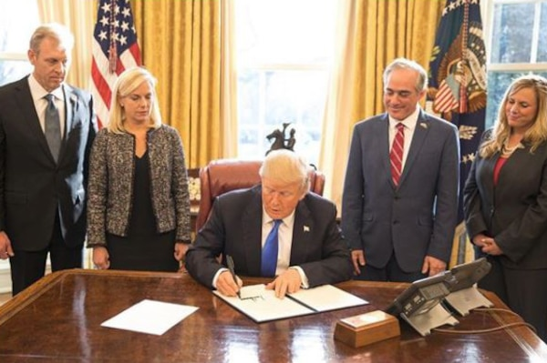 President Donald J. Trump signs an executive order to improve support for military veterans at the White House, Jan. 9, 2018. White House photo