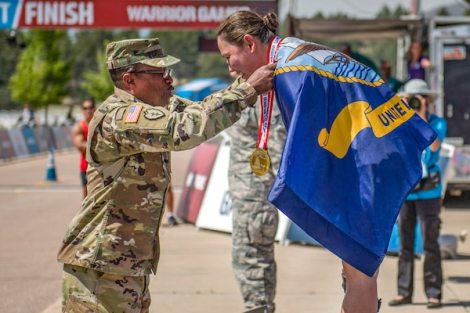Navy Master Chief Petty Officer Raina Hockenberry receives the gold medal in time trial cycling during the 2018 Department of Defense Warrior Games at the U.S. Air Force Academy in Colorado Springs, Colo., June 6, 2018. Navy photo by Petty Officer 3rd Class Morgan K. Nall