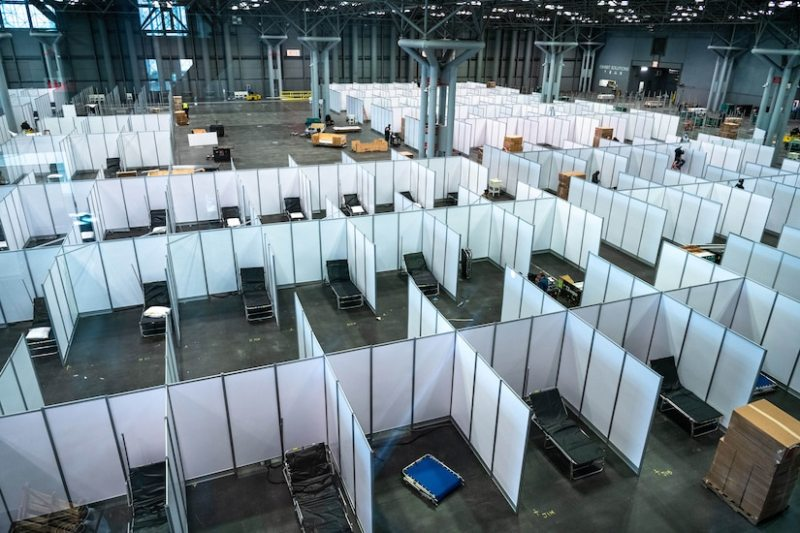 The Federal Emergency Management Agency, the Department of Health and Human Services, the state of New York and the Army Corps of Engineers work to complete the construction of an alternate care facility at the Jacob K. Javits Convention Center in New York City, March 26, 2020. Photo By: K.C. Wilsey, FEMA.