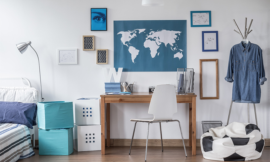 Interior decoration of study room with a bean bag, painting frames and a bold world map lend a millennial-style vibe.