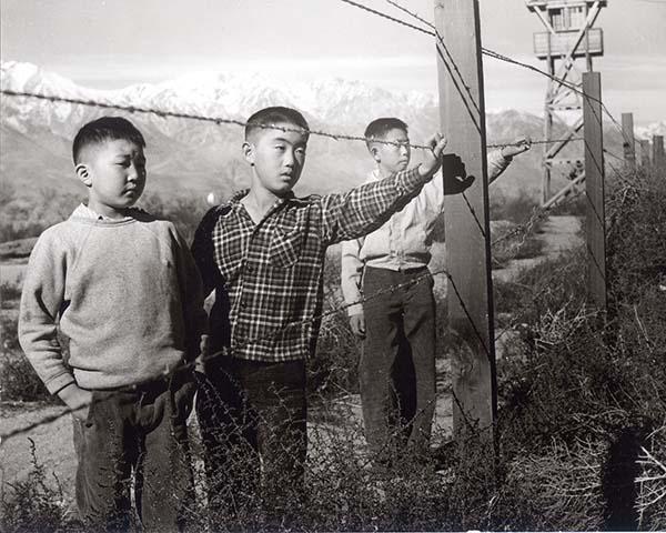 Boys behind wire