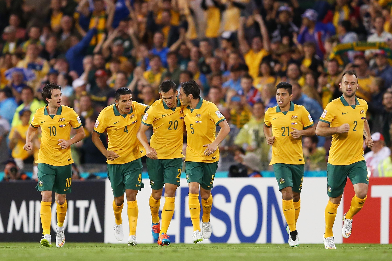 Australian team celebrates after scoring a goal
