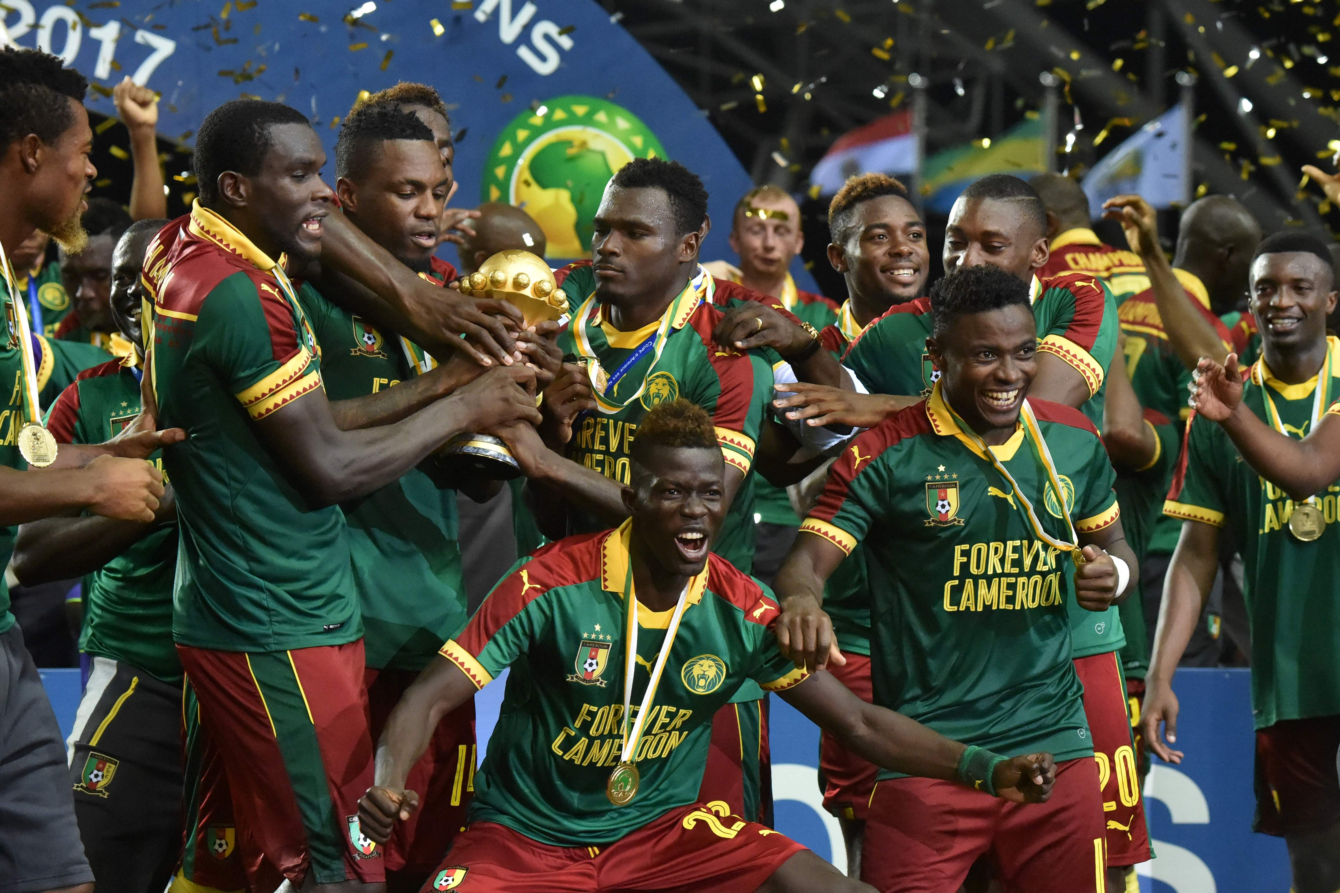 Cameroon's midfielder Christian Bassogog and team mates celebrate beating Egypt 2-1 to win the 2017 Africa Cup of Nations final