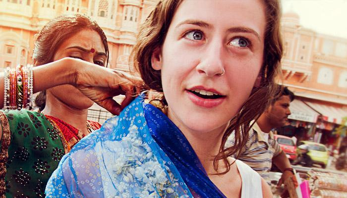 Female tourist trying on saree in market in Jaipur, India