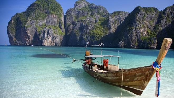 Beautiful Ko Phi Phi Beach in Thailand with a long tail boat.