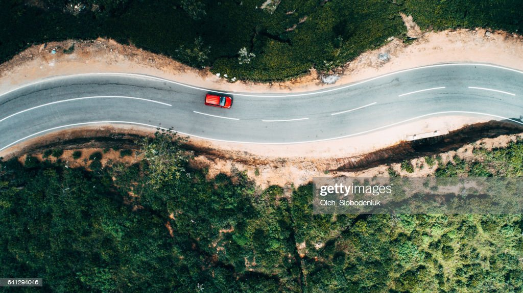 Aerial View On Red Car On The Road Near Tea Plantation ...