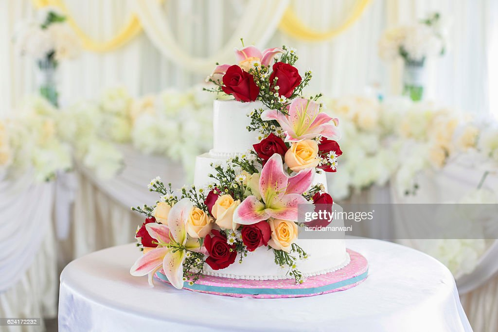 Beautiful White Wedding Cake With Red Roses As Decoration Stock     Beautiful white wedding cake with red roses as decoration    Stock Photo