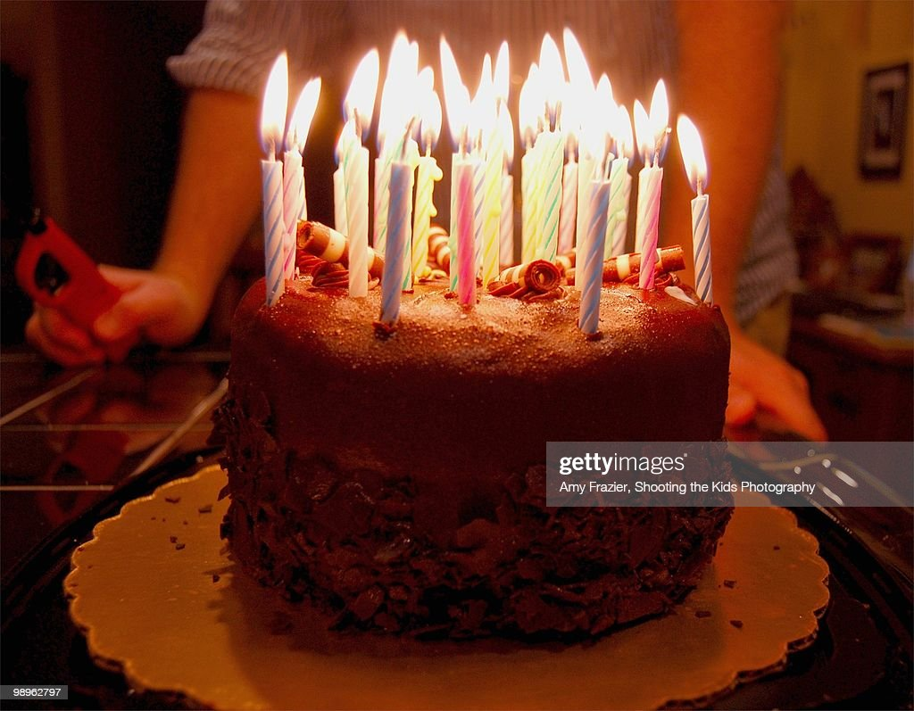 A Birthday Cake Ablaze With Many Candles High Res Stock