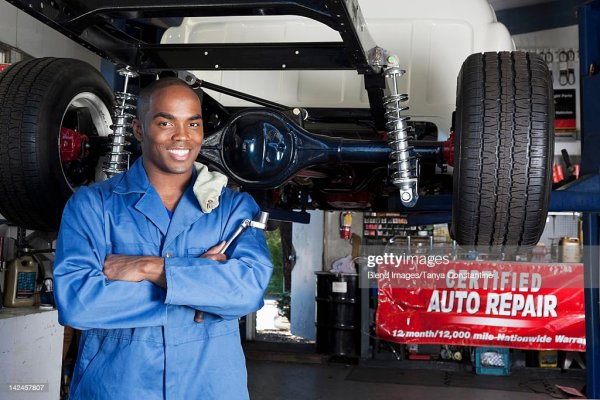 Black Mechanic Working On Car Stock Photo   Getty Images